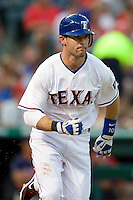 Texas Rangers third baseman Michael Young #10 runs to first during the Major League Baseball game against the Texas Rangers at the Rangers Ballpark in Arlington, Texas on July 27, 2011. Minnesota defeated Texas 7-2.  (Andrew Woolley/Four Seam Images)