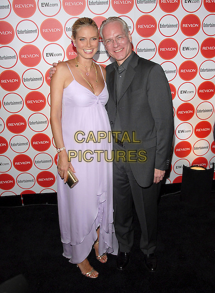 HEIDI KLUM & TIM GUNN.attends The Entertainment Weekly Pre-Emmy Party held at Republic in West Hollywood, California, USA,.August 26, 2006.full length lilac white long dress pregnant.Ref: DVS.www.capitalpictures.com.sales@capitalpictures.com.©Debbie VanStory/Capital Pictures