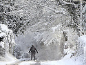 Eoin O'Coisneachain skies his way home from the shops near Lisburn following a heavy snow fall in County Antrim, Friday, December 8th, 2017. Photo/Paul McErlane