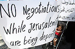 Palestinians hold banners during a protest in front of U.S consulate against the direct talks with Israel in the east Jerusalem on August 30,2010. Photo by Mahfouz Abu Turk