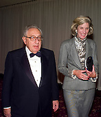 Former United States Secretary of State Henry Kissinger and his wife, Nancy, attend the 1999 White House Correspondents Association Dinner at the Washington Hilton Hotel in Washington, D.C. on May 1, 1999..Credit: Ron Sachs / CNP