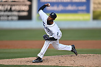Asheville Tourists starting pitcher Antonio Santos (10) delivers a pitch during a game against the Greensboro Grasshoppers at McCormick Field on April 28, 2017 in Asheville, North Carolina. The Grasshoppers defeated the Tourists 3-2. (Tony Farlow/Four Seam Images)
