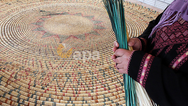 Palestinian elderly woman, Raselah Abed Al-Hafez,70 years, hoping to make it into the Guinness Book of Records, prepare what she calls the biggest hay traditional dish in the world in the West Bank city of Ramallah, June 20,2011. Photo by Issam Rimawi