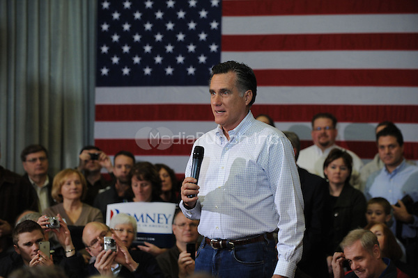 Republican presidential hopeful Mitt Romney speaks during a campaign stop in Council Bluffs, Iowa. January 1, 2012. © mpi01/MediaPunch Inc.