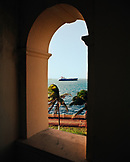 PANAMA, Colon, a container ship waits to pass through the Panama Canal, view from the Washington Hotel, Central America