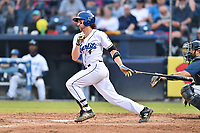 Asheville Tourists shortstop Ryan Vilade (4) swings at a pitch during a game against the Columbia Fireflies at McCormick Field on August 3, 2018 in Asheville, North Carolina. The Fireflies defeated the Tourists 6-3. (Tony Farlow/Four Seam Images)