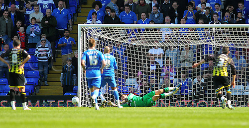 25.03.2012 Birmingham, England. Cardiff Scottish Goalkeeper David Marshall saves a penalty from Birmingham City Jamaican Striker Marlon King during the Football League Championship Match between Birmingham City and Cardiff City, played at St Andrews. ..