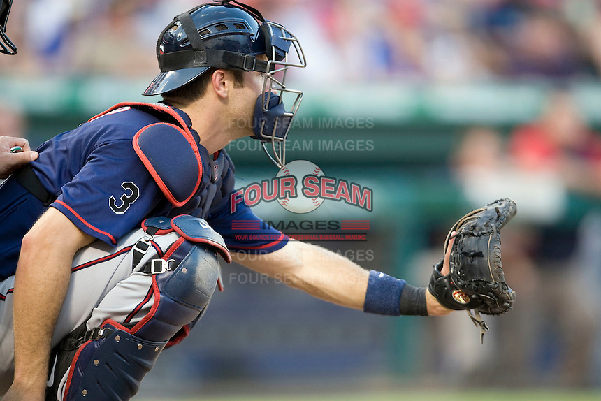 Minnesota Twins catcher Joe Mauer #7 prepares to catch during a Major League Baseball game against the Texas Rangers at the Rangers Ballpark in Arlington, Texas on July 27, 2011. Minnesota defeated Texas 7-2.  (Andrew Woolley/Four Seam Images)