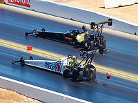 Jul 30, 2017; Sonoma, CA, USA; NHRA top fuel driver Antron Brown (near) races alongside Troy Buff during the Sonoma Nationals at Sonoma Raceway. Mandatory Credit: Mark J. Rebilas-USA TODAY Sports