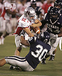 Nevada's Joshua Mauga tries to strip the ball from Nicholls State quarterback Zach Chauvin during Saturday's game, Sept. 15, 2007 in Reno, Nev. .Photo by Cathleen Allison