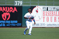 Surprise Saguaros outfielder Julio Pablo Martinez (40), of the Texas Rangers organization, prepares to catch a fly ball during an Arizona Fall League game against the Salt River Rafters on October 9, 2018 at Surprise Stadium in Surprise, Arizona. Salt River defeated Surprise 10-8. (Zachary Lucy/Four Seam Images)