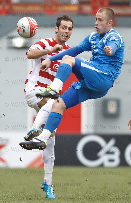 Danny Grainger clears from Flavio Paixao