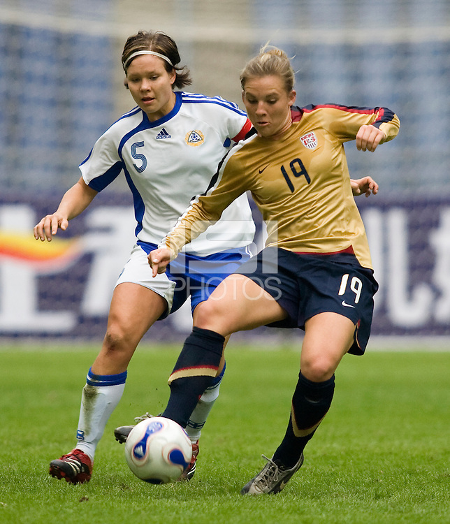 USWNT forward (19) Amy Rodriguez sprints past Finland's (5) Tiina Salmen during the Four Nations Tournament in  Guangzhou, China.  The US defeated Finland, 4-1.