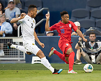 KANSAS CITY, KS - JUNE 26: Jonathan Lewis #18 is pursued by Francisco Palacios #2 during a game between United States and Panama at Children's Mercy Park on June 26, 2019 in Kansas City, Kansas.