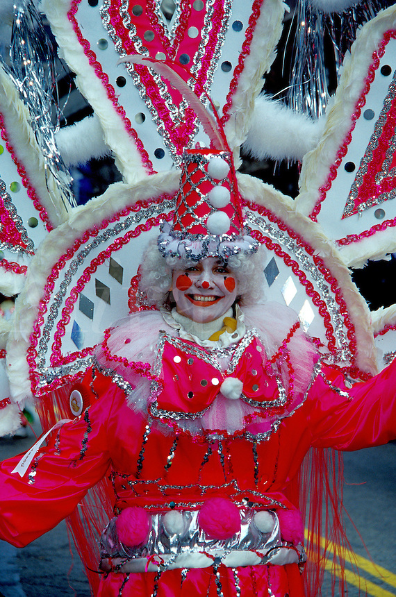 costume, parade, Philadelphia, PA, Pennsylvania, A woman in the Fancy Division is dressed in a pinkish-red clown costume in the Mummers Day Parade on New Years Day in Philadelphia.