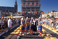 cheese market, Gouda, Netherlands, Holland, Zuid-Holland, Europe, Men testing cheese at the Cheese Market outside Town Hall on Cheese Market Day in downtown Gouda.