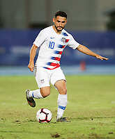 GEORGETOWN, GRAND CAYMAN, CAYMAN ISLANDS - NOVEMBER 19: Cristian Roldan #10 of the Unites States dribbles with the ball during a game between Cuba and USMNT at  Truman Bodden Sports Complex on November 19, 2019 in Georgetown, Grand Cayman.
