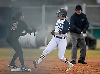 NWA Democrat-Gazette/CHARLIE KAIJO Bentonville West High School catcher Sydney Sneed (25) runs to second during a softball game, Thursday, March 13, 2019 at Bentonville West High School in Centerton.