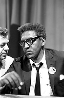 Washington (D.C.) USA - 1963 Aug. 27 -<br /> .Bayard Rustin at news briefing on the Civil Rights March on Washington in the Statler Hotel, half-length portrait, seated at table]