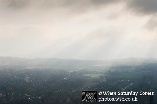 The sun struggling to break through clouds above the town of Stocksbridge. Stocksbridge Park Steels v Pickering Town, Evo-Stik East Division, 17th November 2018. Stocksbridge Park Steels were born from the works team of the local British Steel plant that dominates the town north of Sheffield.<br />