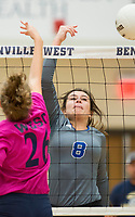 NWA Democrat-Gazette/CHARLIE KAIJO Rogers High School outside hitter Madelyn Tauai (8) tips the ball to the outside during the girl's volleyball game on Thursday, October 12, 2017 at Bentonville West High School in Centerton.