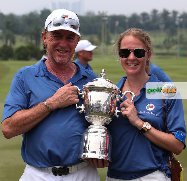 Team Europe Captain, Miguel Angel Jimenez (ESP) and girlfriend with the Trophy after the final day of Singles matches at the 2014 EurAsia Cup presented by DRB-Hicom, at the Glenmarie Golf & Country Club, Kuala Lumpur, Malaysia. Picture:  David Lloyd / www.golffile.ie