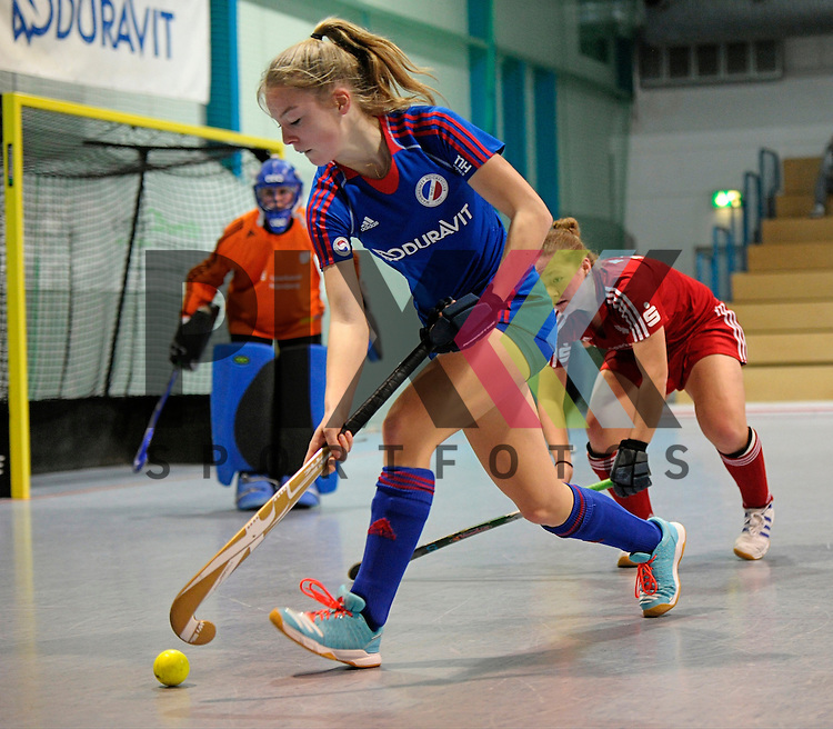 GER - Mannheim, Germany, December 19: During the 1. Bundesliga Sued Damen indoor hockey match between Mannheimer HC (blue) and Nuernberger HTC (red) on December 19, 2015 at Irma-Roechling-Halle in Mannheim, Germany.  Antonia Hering #34 of Mannheimer HC<br /> <br /> Foto &copy; PIX-Sportfotos *** Foto ist honorarpflichtig! *** Auf Anfrage in hoeherer Qualitaet/Aufloesung. Belegexemplar erbeten. Veroeffentlichung ausschliesslich fuer journalistisch-publizistische Zwecke. For editorial use only.