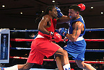 Cam Awesome, left, and Derae Crane compete in the U.S. Olympic Boxing Trials in Reno, Nev., on Wednesday, Dec. 9, 2015. (AP Photo/Cathleen Allison)