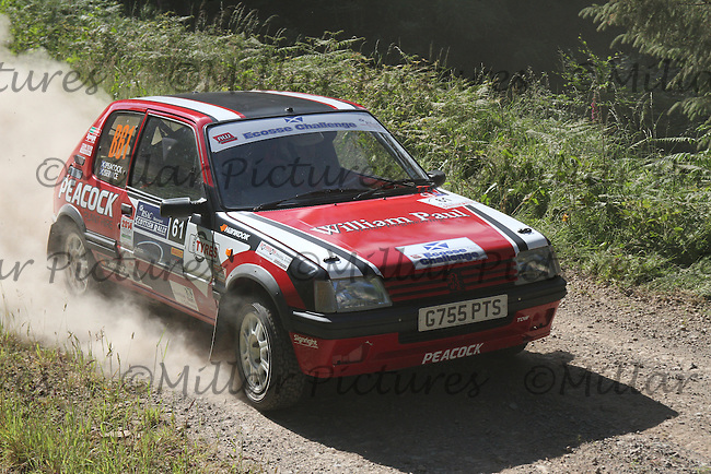 Scott Peacock - Craig Service in a Peugeot 205 Gti at Junction 11 on the Windy Hill Special Stage of the RSAC Scottish Rally 2014, Round 3 of the MSA British Rally Championship, Round 4 of the RAC MSA Scottish Rally Championship sponsored by ARR Craib Transport Limited and other championships which was organised by the Royal Scottish Automobile Club and based at Dumfries on 27-28.6.14.