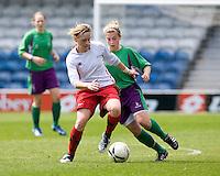 29 APR 2009 - LONDON,GBR - Gemma Wilson (left) - Leeds Met Carnegie (green and purple) v Northumbria University (white and red) - BUCS Womens Football Championships '09. (PHOTO (C) NIGEL FARROW)