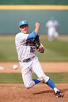 David Berg #26 of the UCLA Bruins pitches against the Washington Huskies at Jackie Robinson Stadium on March 17, 2013 in Los Angeles, California. (Larry Goren/Four Seam Images)