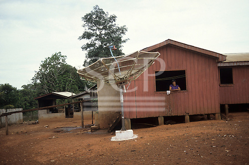 Acre, Brazil. Caboclo settler's house with satellite television dish in a remote frontier border region.