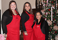 NWA Democrat-Gazette/CARIN SCHOPPMEYER Madison Livingston (from left), Madeline Olander and Marcelina Campos help with the Junior League home tour on Dec. 8.