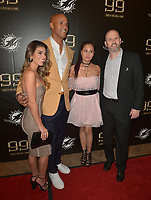MIAMI GARDENS, FL - DECEMBER 02: Jason Taylor and girlfriend Monica Velasco (L) and guest attend The Miami Dolphins 'Hall of Fame Celebration' hosting Jason Taylor at Hard Rock Stadium on December 02, 2017 in Miami Gardens, Florida. Credit: MPI10 / MediaPunch