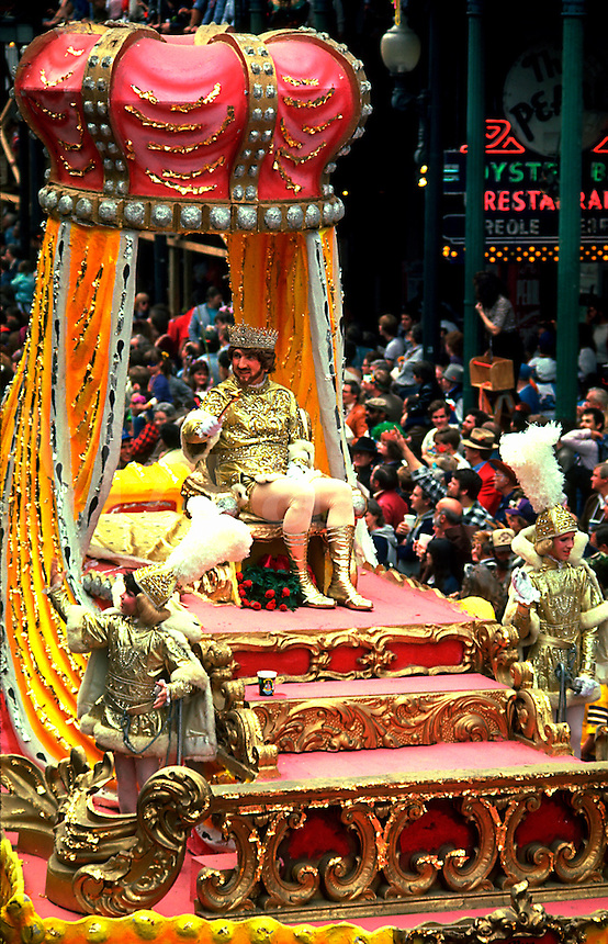 The elaborate parade float of Rex - King of Mardi Gras with onlooking crowds. New Orleans, Louisiana.