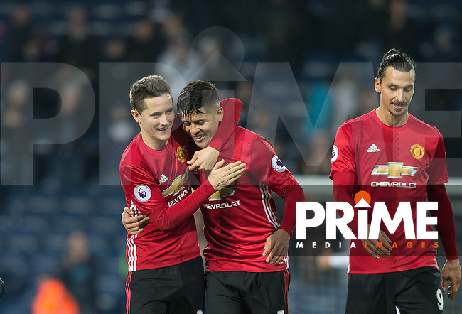 Ander Herrera embraces Marcos Rojo of Manchester United at full time during the EPL - Premier League match between West Bromwich Albion and Manchester United at The Hawthorns, West Bromwich, England on 17 December 2016. Photo by Andy Rowland / PRiME Media Images.