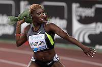 L'ivoriana Murielle Ahoure lancia i fiori al pubblico dopo aver vinto i 100 metri donne durante il Golden Gala di atletica leggera allo stadio Olimpico di Roma, 31 maggio 2012..Ivory Coast's Murielle Ahoure throws flowers to spectators after winning the women's 100 meters during the IAAF athletic Golden Gala meeting at Rome's Olympic stadium, 31 may 2012..UPDATE IMAGES PRESS/Riccardo De Luca