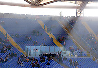 Calcio, Serie A: Roma vs Genoa. Roma, stadio Olimpico, 20 dicembre 2015.<br /> Roma fans seat in a Curva Sud almost empty due to a protest against security measurements during the Italian Serie A football match between Roma and Genoa at Rome's Olympic stadium, 20 December 2015.<br /> UPDATE IMAGES PRESS/Riccardo De Luca