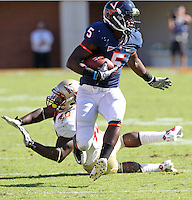 Oct 2, 2010; Charlottesville, VA, USA; Virginia Cavaliers running back Torrey Mack (5) runs past Florida State Seminoles linebacker Jeff Luc (48) during the game at Scott Stadium. Florida State won 34-14.  Mandatory Credit: Andrew Shurtleff-