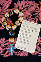 Kukui nut rosary with cross and Hawaiian translation of the prayer of St. Francis of Assisi, taken at St. Benadict painted church, South Kona, Big island