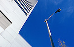 Looking up at lamp post and building with repeating lines and blue sky, Seattle Washington USA