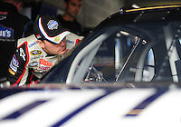 Nov. 20, 2009; Homestead, FL, USA; NASCAR Sprint Cup Series driver Jimmie Johnson looks into his car prior to practice for the Ford 400 at Homestead Miami Speedway. Mandatory Credit: Mark J. Rebilas-