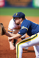 Michigan Wolverines first baseman Carmen Benedetti (43) waits for a throw during the second game of a doubleheader against the Canisius College Golden Griffins on February 20, 2016 at Tradition Field in St. Lucie, Florida.  Michigan defeated Canisius 3-0.  (Mike Janes/Four Seam Images)