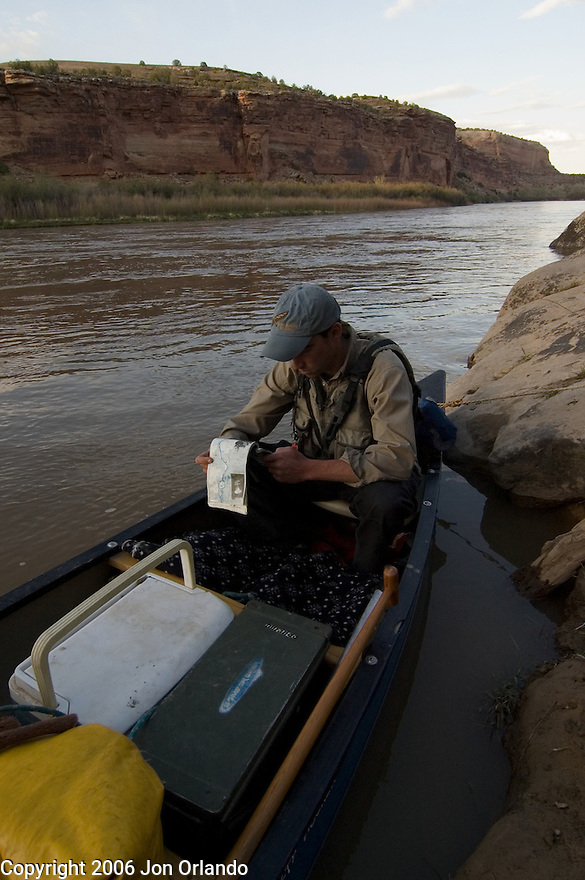 Dave Gentempo studies a map at a resting point in Horsethief Canyon on the Colorado River.