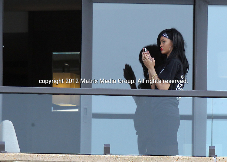 8th April, 2012  Sydney, Australia..NON EXCLUSIVE ..Rihanna poses for a self porttrait with her iphone on the balcony of her hotel overlooking Sydney Harbour.
