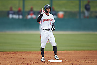 Tyler Frost (1) of the Kannapolis Intimidators waves to the dugout after hitting a double against the Lakewood BlueClaws at Kannapolis Intimidators Stadium on April 8, 2018 in Kannapolis, North Carolina.  The Intimidators defeated the BlueClaws 4-3 in game two of a double-header.  (Brian Westerholt/Four Seam Images)