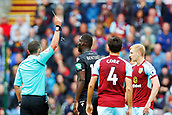 10th September 2017, Turf Moor, Burnley, England; EPL Premier League football, Burnley versus Crystal Palace; Christian Benteke of Crystal Palace is cautioned and shown the yellow card by referee Michael Oliver