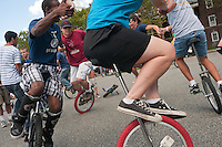 Governor's  Island, NY -  4 September 2010 Five unicyclists ride in a circle at the second day of the New York City Unicycle Festival on Governor's Island.