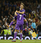 Luka Modric of Real Madrid celebrates with Cristiano Ronaldo of Real Madrid during the Champions League Final match at the Millennium Stadium, Cardiff. Picture date: June 3rd, 2017.Picture credit should read: David Klein/Sportimage
