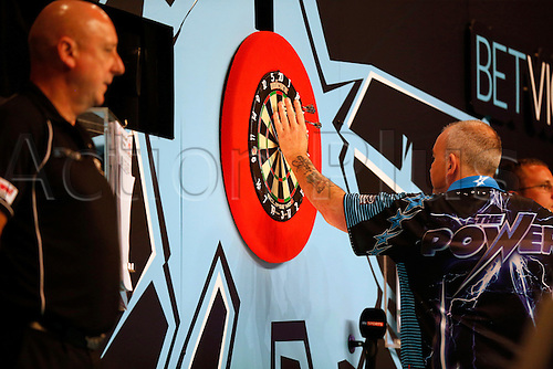 24.07.2016. Empress Ballroom, Blackpool, England. BetVictor World Matchplay Darts. Phil Taylor picks his darts out of the board